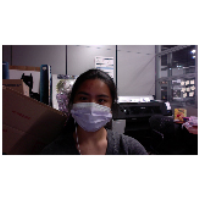 Gabby wears a nose/mouth face mask in the greenre office.